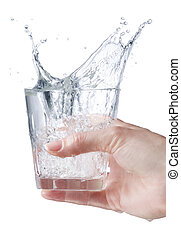 water - womans hand holding glass of water splashing