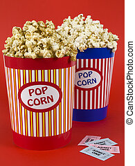 Doble date night - Two popcorn buckets over a red background...