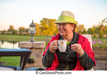 Tea Time to Stay Warm, Senior Lady with her Hot Tea