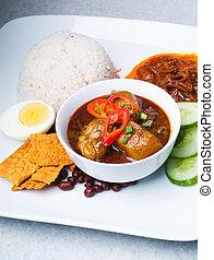 Nasi lemak traditional spicy rice dish - Nasi lemak...