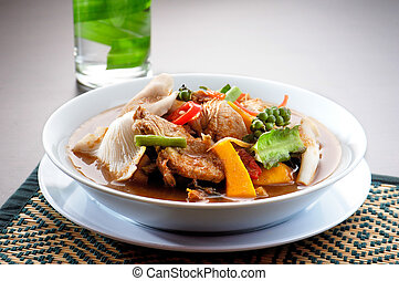 chicken wing tom yum bowl Thai food on background - Thai Tom...