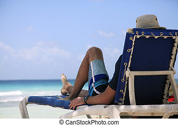 Man on beach - Man has a rest in an armchair