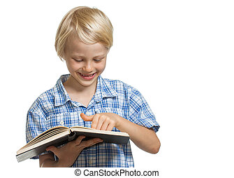 Smiling boy holding book and pointing