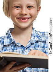 Happy boy reading book - Close-up of a happy young boy...