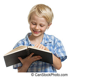 Happy boy reading a book