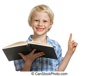 Happy boy holding book and pointing - A happy smiling young...