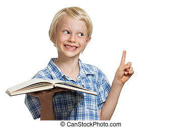 Young boy holding book and pointing - A cute smiling young...