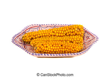 maize cobs in decorative plate isolated on white