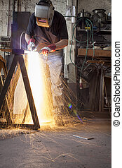Metalworking - Plasma cutting in a metal workshop with man...