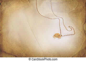 Golden pendant with heart