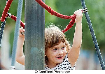 baby girl climbing at ropes - baby girl climbing at ropes on...