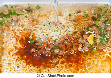 cooking of instant noodles close up