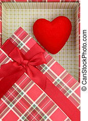 Present box with red heart inside