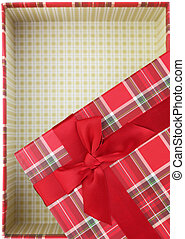 Top of empty present box with red ribbon