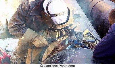 Close up shot welder until welding, - Welder working on a...