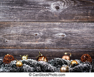Christmas tree with golden baubles on wood texture