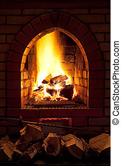 fire in home fireplace - poker, firewood and of fire in home...