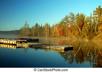 Dock at sunrise over beautiful lake