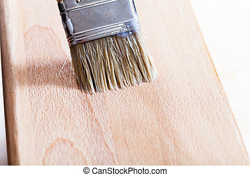 putting varnish on beach wooden board - putting layer of...