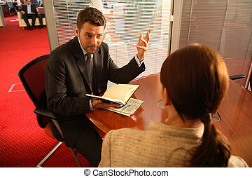 Business man and woman talking in the office - Business man...
