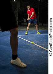 Paddle tennis copule - Paddle tennis player in court ready...