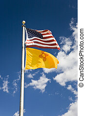 Flag USA and New Mexico, blue sky with clouds