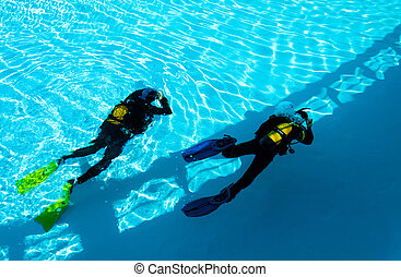 Diver Training - Two divers are trained in the pool