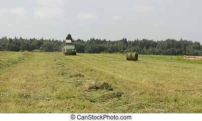 tractor gather hay bale - Straw bale and agricultural...