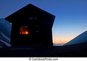 Scenic eco tourism in the Alps - High altitude alpine hut...