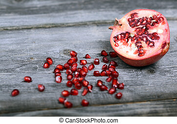 Pomegranate fruit on wooden floor