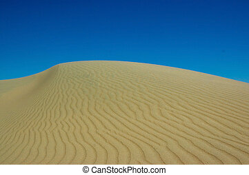 Sand dune in Patagonia - Sand dune against the sky in...