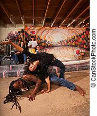 Capoeira Performers Twisting - Hispanic capoeira experts...