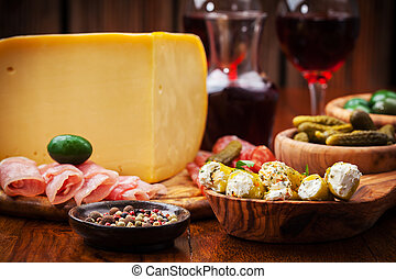 Antipasto catering platter with cheese loaf