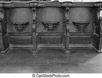 Wooden choir stalls a church in France - Black and white...