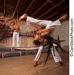 Capoeira Performers Shoulder Throw - Capoeira man throwing...