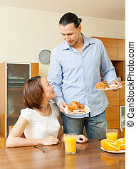 Young adult couple having breakfast