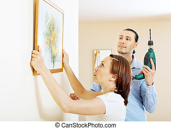 serious couple choosing place for picture