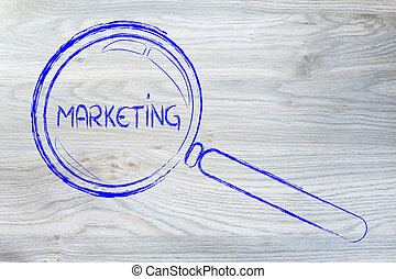 magnifying glass focusing on marketing and communication -...