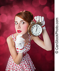 Beautiful redhead women with clock Photo in retro style with...