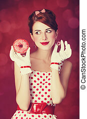 Beautiful redhead women with donut Photo in retro style with...