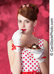 Beautiful redhead women with candy Photo in retro style with...