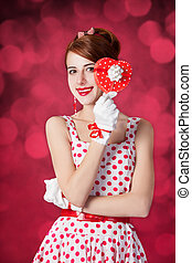 Beautiful redhead women with gift Photo in retro style with...