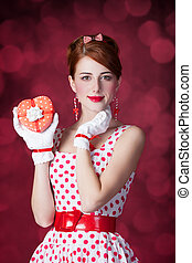 Beautiful redhead women with gift. Photo in retro style with...