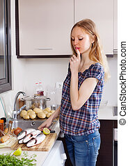 woman  thinking how to cook fish