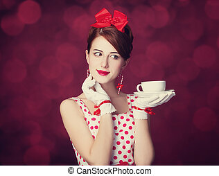 Beautiful redhead women with cup of tea Photo in retro style...