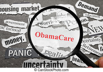 Obama Care headline - Magnifying glass looking at newspaper...