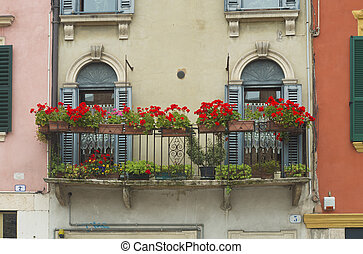 balcony with flowers - characteristic Italian balcony with...