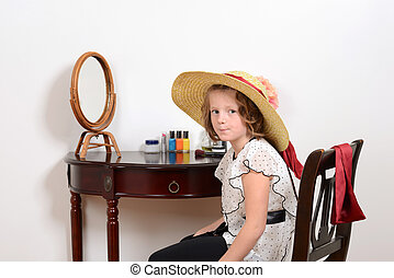 little girl playing dress up in her moms room