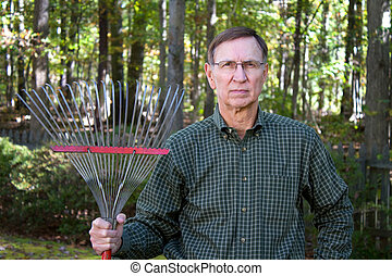 Senior Man With Rake