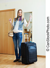 Smiling woman with suitcase